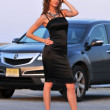 Fashion model posing pretty in front of sport SUV in New York NY — Stock Photo #18362173