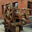 Old rusty motor outside of building - Stock Photo