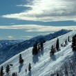 On the top of the World - Snow and Sky. Snowbasin mountain, Utah - Stock Photo