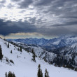 Spectacular view to the Mountains from summit of Alta ski resort in Utah — Stock Photo #18539791