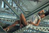 Girl wears bikini standing under the bridge — Stock Photo