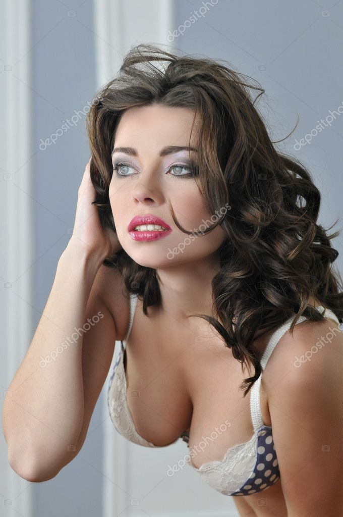 Portrait of blue eyed brunette looking pretty in Lingerie — Stock Photo #18628205