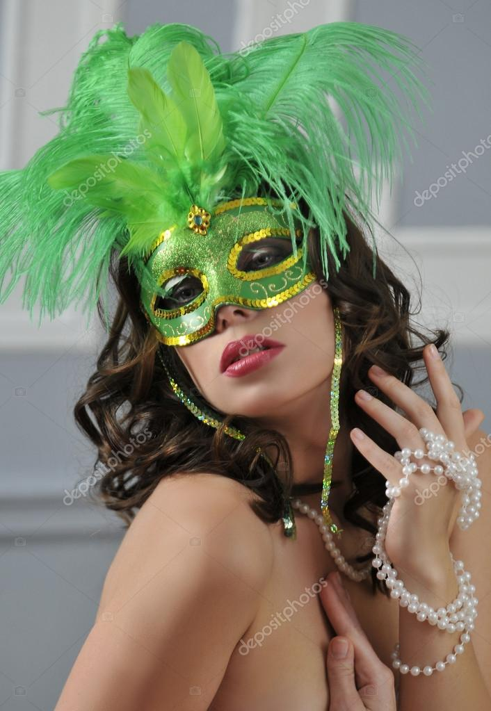 The beautiful young girl in a mysterious mask  — Stock Photo #18628249