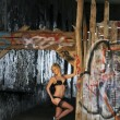 Gorgeous blond young woman next to a wall of graffiti wearing lingerie — Stock Photo