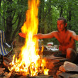 Calling spirits over campground fire - Stockfoto