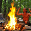 Calling spirits over campground fire - Foto Stock