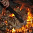Cooking on campfire at night - Stock Photo