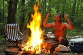 Calling spirits over campground fire — Stock Photo