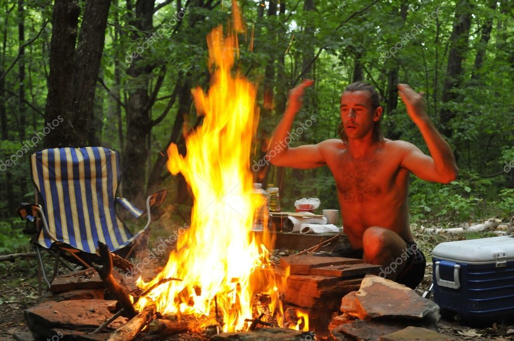 Calling spirits over campground fire — Stok fotoğraf #18659833