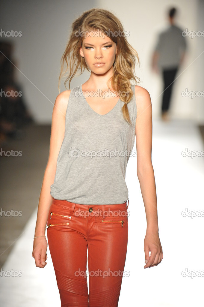 NEW YORK, NY - SEPTEMBER 05: A model walks the runway at the DL 1961 Premium Denim spring 2013 fashion show during Mercedes-Benz Fashion Week at Pier 57 on September 5, 2012 in New York City  Stock Photo #19354329