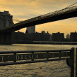 New York City evening skyline with Brooklyn Bridge over Hudson River - ストック写真