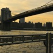 New York City evening skyline with Brooklyn Bridge over Hudson River — Stok fotoğraf