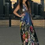 Fashion model posing in long blue dress in front of Brooklyn Bridge in New York City — Stock Photo #19684069