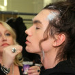 Makeup artist Charlie Green applying make-up to model backstage at the Elliott Evan Collection  for Fall Winter 2013 during Mercedes-Benz Fashion Week on February 07, 2013 in NYC. - Stock Photo
