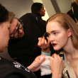 NEW YORK - FEBRUARY 10: A model gets ready backstage for Victor de Souza collection at the Strand hotel during Mercedes-Benz Fashion Week on February 10, 2013 in New York City — Stock Photo #21272751