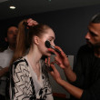 NEW YORK - FEBRUARY 10: A model gets ready backstage for Victor de Souza collection at the Strand hotel during Mercedes-Benz Fashion Week on February 10, 2013 in New York City — Stock Photo #21272855
