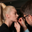 NEW YORK - FEBRUARY 10: A model gets ready backstage for Victor de Souza collection at the Strand hotel during Mercedes-Benz Fashion Week on February 10, 2013 in New York City — Stock Photo #21272871