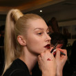 NEW YORK - FEBRUARY 10: A model gets ready backstage for Victor de Souza collection at the Strand hotel during Mercedes-Benz Fashion Week on February 10, 2013 in New York City — Stock Photo #21272879