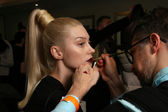 NEW YORK - FEBRUARY 10: A model gets ready backstage for Victor de Souza collection at the Strand hotel during Mercedes-Benz Fashion Week on February 10, 2013 in New York City — Stock Photo