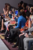 NEW YORK - FEBRUARY 17: in the crowd shoot models on runway with cell phones and tablets at Allex Kangala collection at New Yorkek Hotel during Couture Fashion Week on February 17, 2013 — Stock Photo