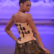 NEW YORK - FEBRUARY 17: A Model walks on the Ariel Cedeno fashion runway at The New Yorker Hotel during Couture Fashion Week on February 17, 2013 in New York City — Foto de Stock