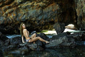 Swimsuit model posing sexy in front of black lava field on at Palos Verdes, CA — Stock Photo