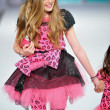 Los Angeles - March 13: A child model walks the runway at the Hollywood kids Fall Winter 2013 fashion show during STYLE Fashion Week at Vibiana Cathedral on March 13, 2013 in Los Angeles, CA - Stock Photo