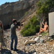 Photo video crew on location set with bikini models - Stock Photo