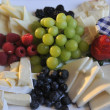 Different tasty snacks and cheese for wine - Stock Photo