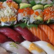 Sushi, sashimi, rolls on tray closeup - Stockfoto