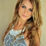 Glamor blond girl posing pretty outside wearing designers lingerie and custom jewelery — Stock Photo #25078467