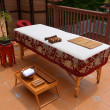 Oriental style massage table outside on the balcony — Stock Photo