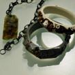 Decorative bracelets on matt surface with reflections - 图库照片
