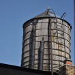 Water supply tank at New York City rooftop — Stock Photo #25525747
