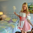 Stock Photo: Blond girl as french maid in bedroom