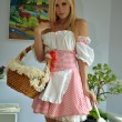 Blond girl as french maid in the bedroom — Stock Photo