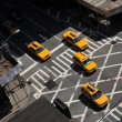 Yellow cabs going downtown at Lexington Avenue, upper east side Manhattan New York NY - Stock Photo