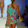 A model walks the runway at the Caffe Swimwear show — Stock Photo