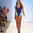 A model walks the runway at the A.Che Swimwear show — Stock Photo