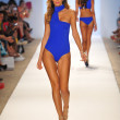 A model walks the runway at the Aquarella Swimwear show — Photo