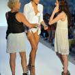 Stock Photo: Designer PaolRobb(L) walks runway at Poko Pano show