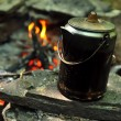 Coffee pot at campground with fire on background — Stock Photo