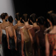Stock Photo: Models walk runway finale at CarolinHerrershow