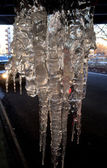 Winter background with icicles — Stock Photo