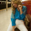 Girl sitting on the bench at empty subway station — Stock Photo