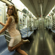 Girl wearing a short sexy dress in a subway train — Stock Photo