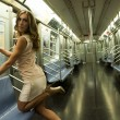 Girl wearing a short sexy dress in a subway train — Stock Photo #37981651