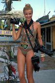 Model holding professional photo cameras — Stock Photo
