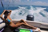 Girl relaxing on motor boat — Stock Photo