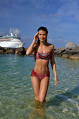 Bikini model standing at shallow water — Stock Photo